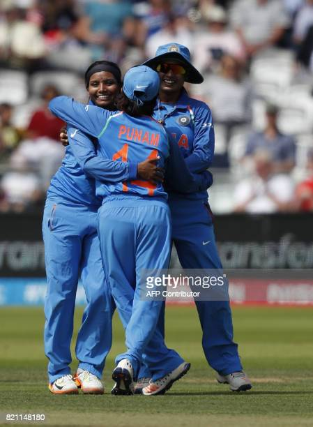 India's Rajeshwari Gayakwad celebrates with teammates after taking the wicket of England's Lauren Winfield during the ICC Women's World Cup cricket...