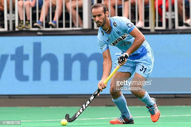 India's Ramandeep Singh controls the ball during the field hockey match between Pakistan and India in the men's Group A of the World League semifinal...