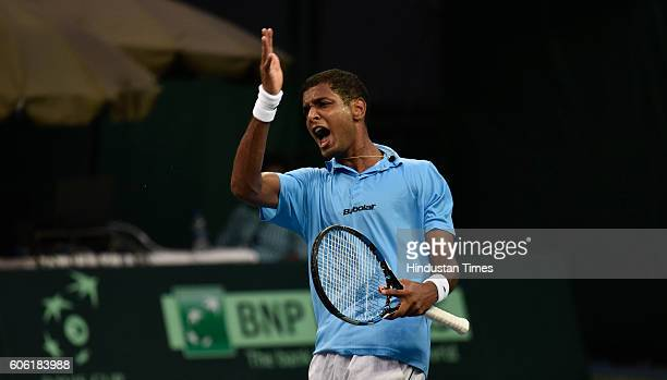 India's Ramkumar Ramanathan exalts after taking point against Spain'n F Lopez during Davis Cup World Group playoff Tie between India and Spain at...