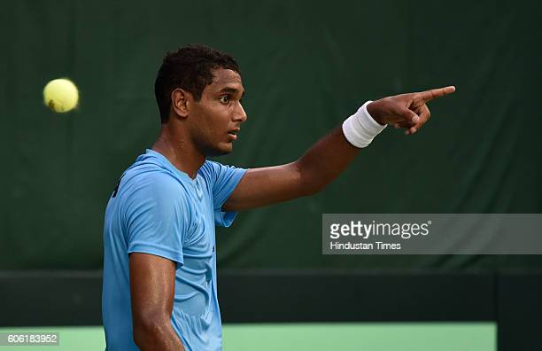 India's Ramkumar Ramanathan exalts after taking point against Spain's F Lopez during Davis Cup World Group playoff Tie between India and Spain at...