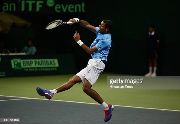 India's Ramkumar Ramanathan in action against Spain's F Lopez during Davis Cup World Group playoff Tie between India and Spain at DLTA on September...
