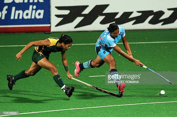 India's Rani Rampal fights for the ball with South Africa's Marsha Mareschia during their field hockey match at the Major Dhyan Chand National...