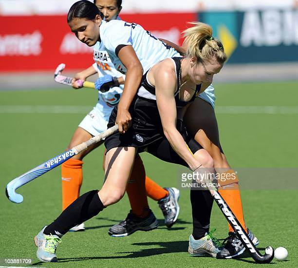 India's Rani Rampal tries to mark New Zealand's Anita Punt during a field hockey Group A match for the Women's World Cup 2010 in Rosario Argentina on...