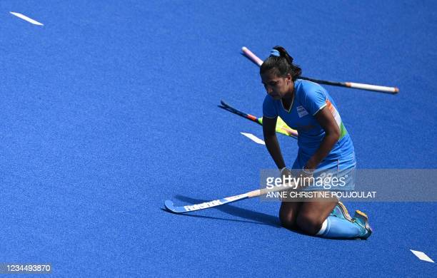 India's Rani reacts after losing the women's bronze medal match of the Tokyo 2020 Olympic Games field hockey competition to Britain 4-3, at the Oi...
