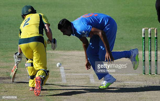 India's Ravi Ashwin attempts to stop the ball alongside batsman George Bailey during the oneday international cricket match between India and...