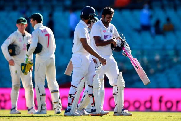 India's Ravichandran Ashwin and Hanuma Vihari walk off the field at the end of the third cricket Test match between Australia and India at the Sydney...