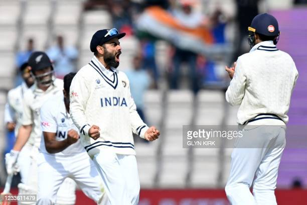 India's Ravichandran Ashwin and India's Virat Kohli celebrates dismissing New Zealand's Devon Conway for 19 runs on the final day of the ICC World...