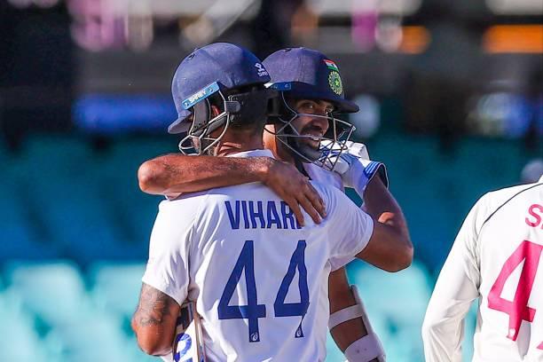 India's Ravichandran Ashwin embraces his teammate Hanuma Vihari at the end of the third cricket Test match between Australia and India at the Sydney...