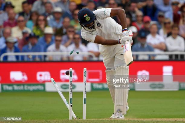 India's Ravichandran Ashwin loses his middle stump bowled by England's Stuart Broad during play on the second day of the third Test cricket match...