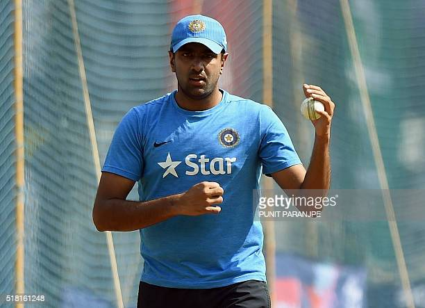 India's Ravichandran Ashwin prepares to bowl during a training session at The Wankhede Cricket Stadium in Mumbai on March 30 2016 India plays their...