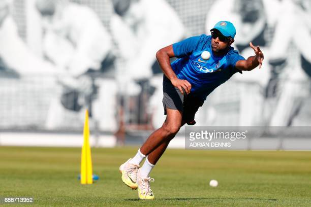 India's Ravichandran Ashwin takes a catch during a practice session at Lord's Cricket Ground in London on May 26 2017 ahead of the start of the 2017...
