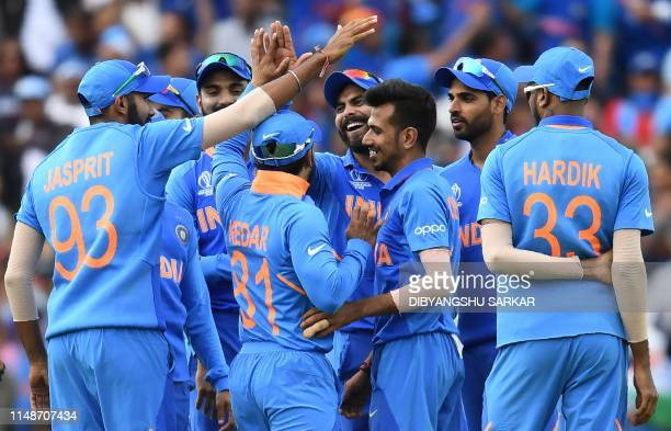 India's Ravindra Jadeja celebrates after taking a catch to dismiss Australia's Glenn Maxwell during the 2019 Cricket World Cup group stage match...