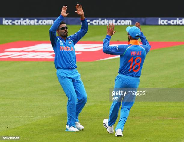 India's Ravindra Jadeja celebrates the wicket of New Zealand's Luke Ronchi with India's captain Virat Kohli during the ICC Champions Trophy Warmup...