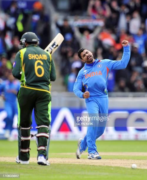 India's Ravindra Jadeja celebrates trapping Pakistan's Shoaib Malik LBW for 17 runs during the 2013 ICC Champions Trophy cricket match between...