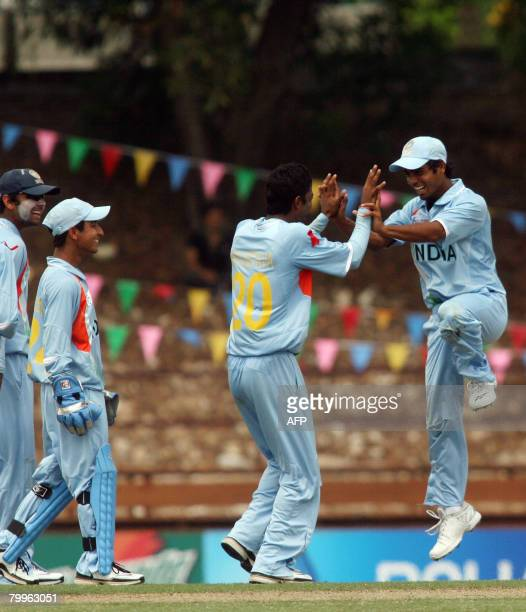 India's Ravindra Jadeja celebrates with teammates his wicket of England's Ben Brown during their ICC Under-19 quarter-final cricket match at the...