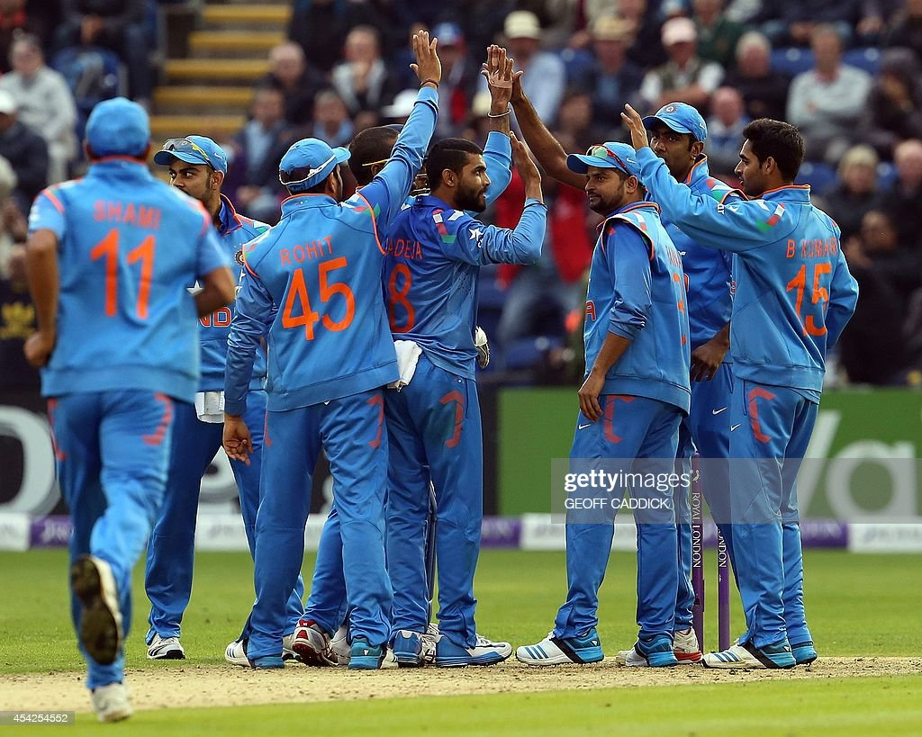 India's Ravindra Jadeja in (C) is congratulated after taking an English wicket in the second one-day international cricket match between England and India at the Glamorgan County Cricket Ground in Cardiff, Wales on August 27, 2014. India won by 133 runs.