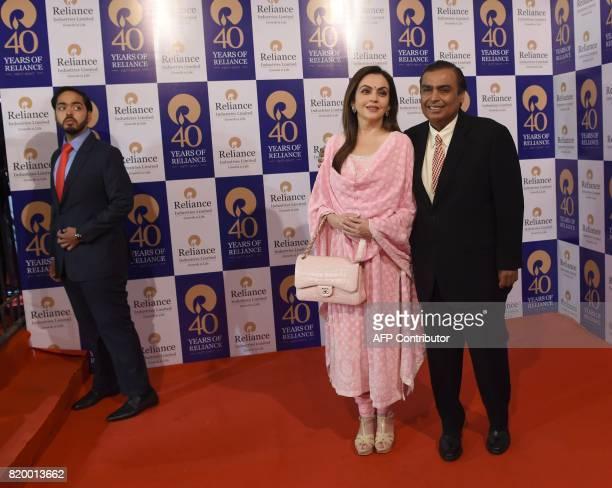 India's richest man and oiltotelecom conglomerate Reliance Industries chairman Mukesh Ambani and his wife Nita Ambani pose as their son Anant Ambani...