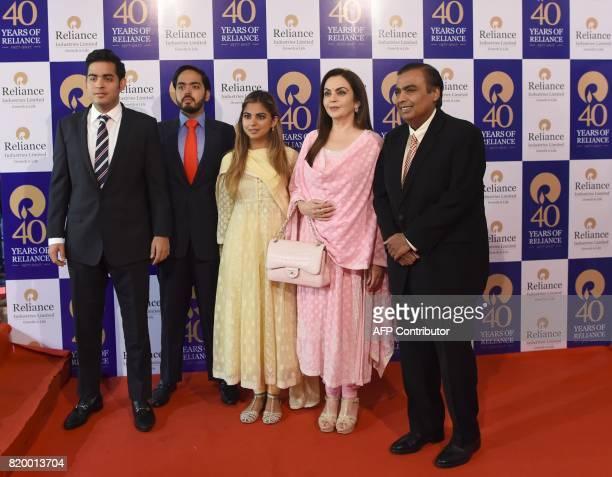 India's richest man and oiltotelecom conglomerate Reliance Industries chairman Mukesh Ambani and his wife Nita Ambani pose with their children Akash...