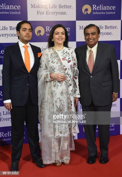 India's richest man and oiltotelecom conglomerate Reliance Industries chairman Mukesh Ambani along with his wife Nita Ambani and their son Anant...