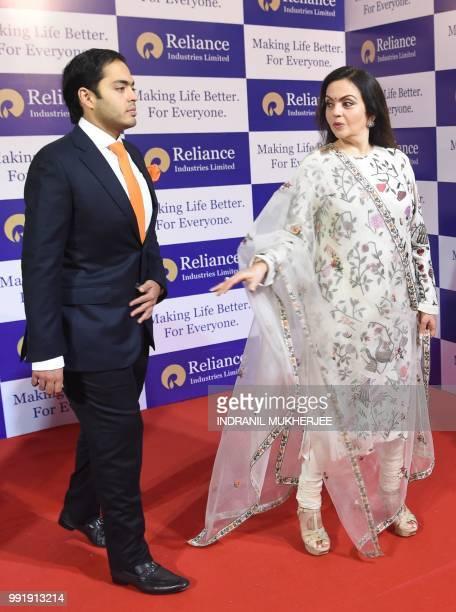 India's richest man and oiltotelecom conglomerate Reliance Industries chairman Mukesh Ambani's wife Nita Ambani and their son Anant Ambani arrive for...