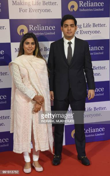 India's richest man and oiltotelecom conglomerate Reliance Industries chairman Mukesh Ambani's children Isha and Akash arrive for the company's 41st...