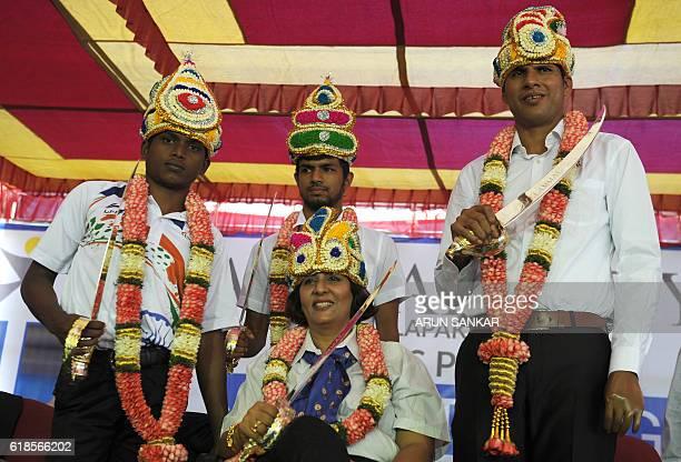 India's Rio Paralympic Games gold medalist Mariyappan Thangavelu bronze medalist Bhati Varun Singh silver medalist Deepa Malik and gold medalist...