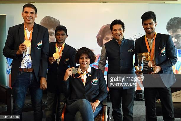 India's Rio Paralympic Games gold medalists Devendra Jhajharia and Mariyappan Thangavelu silver medalist Deepa Malik and bronze medalist Bhati Varun...