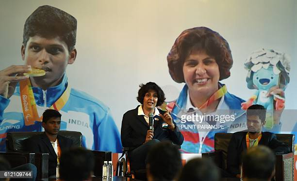 India's Rio Paralympic Games silver medalist Deepa Malik speaks as gold medalist Mariyappan Thangavelu and bronze medalist Bhati Varun Singh listen...