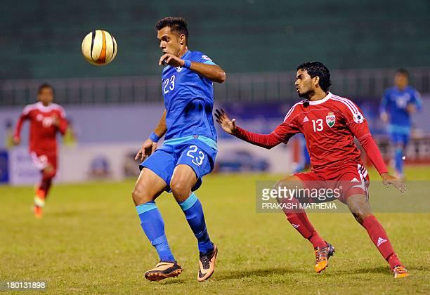 India's Robin Singh vies with Maldives's Akram abul Gani during their SAFF Championships semi final football match in Kathmandu on September 9 2013...