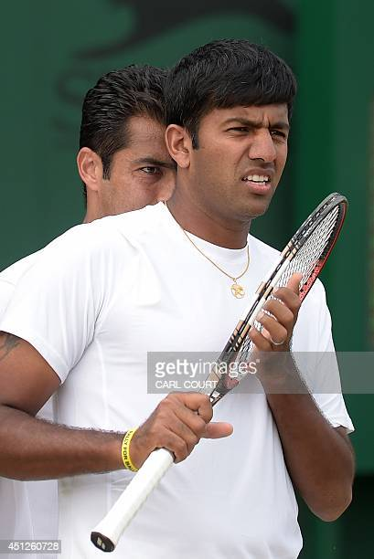 India's Rohan Bopanna and Pakistan's Aisam Qureshi prepare to play against Czech Republic's Frantisek Cermak and Russia's Shuai Zhang during their...