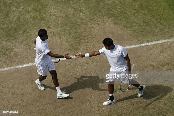 India's Rohan Bopanna and Pakistan's AisamUlHaqQureshi play against Austrian player Jurgen Melzer and Germany's Philipp Petzschner during their men's...