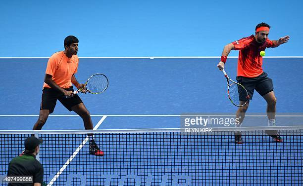 India's Rohan Bopanna and Romania's Florin Mergea return to Britain's Jamie Murray and Australia's John Peers during the men's doubles group stage...