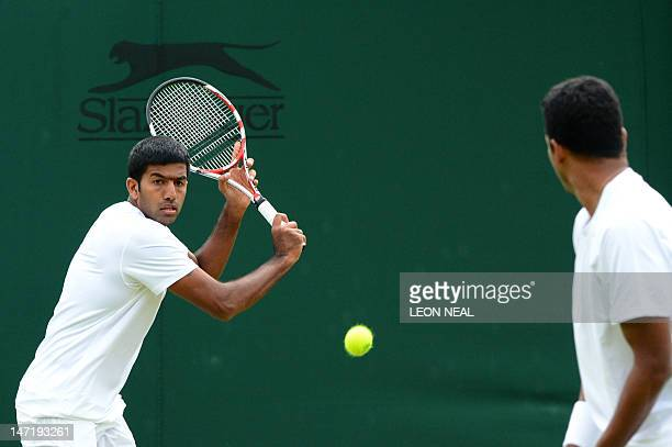 India's Rohan Bopanna plays a shot during his first round men's doubles match with India's Mahesh Bhupathi against Uruguay's Marcel Feldeon and...