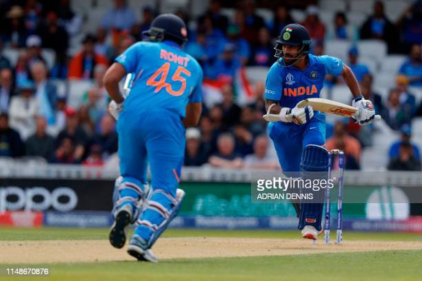 India's Rohit Sharma and India's Shikhar Dhawan run between the wickets during the 2019 Cricket World Cup group stage match between India and...