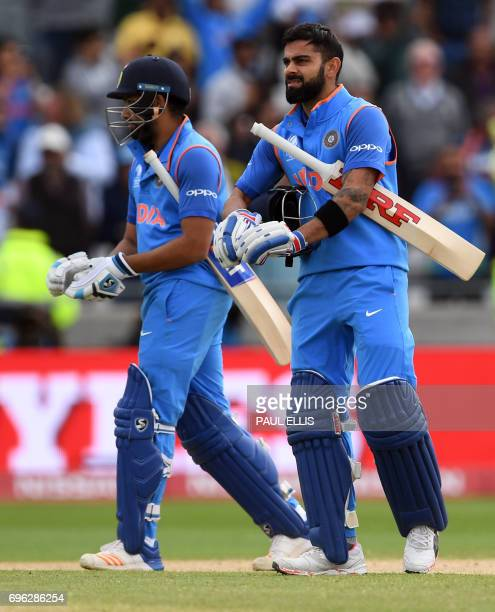 India's Rohit Sharma and Virat Kohli celebrate their winning the ICC Champions Trophy semifinal cricket match between India and Bangladesh at...