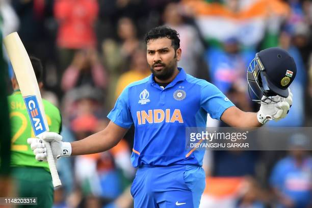 TOPSHOT India's Rohit Sharma celebrate reaching his century during the 2019 Cricket World Cup group stage match between South Africa and India at the...
