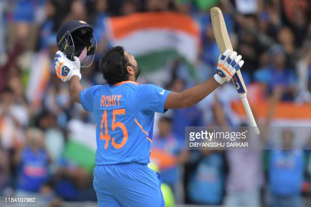 India's Rohit Sharma celebrates after reaching his century during the 2019 Cricket World Cup group stage match between Sri Lanka and India at...