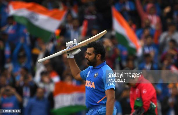 India's Rohit Sharma celebrates after scoring a century during the 2019 Cricket World Cup group stage match between India and Pakistan at Old...