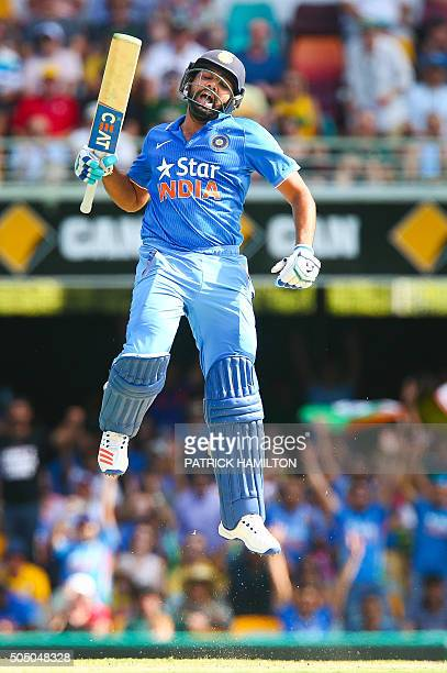 TOPSHOT India's Rohit Sharma celebrates his century during the oneday international cricket match between India and Australia in Brisbane on January...