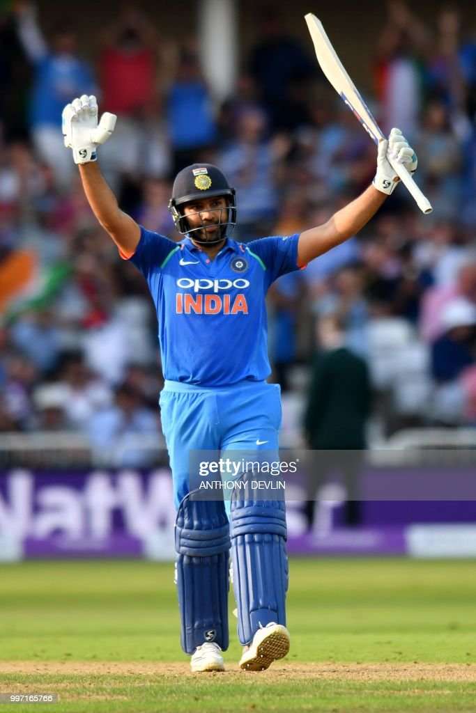 India's Rohit Sharma celebrates scoring 100 not out during the One Day International (ODI) cricket match between England and India at Trent Bridge in Nottingham central England on July 12, 2018. (Photo by Anthony Devlin / AFP) / RESTRICTED
