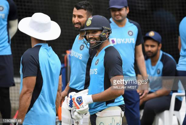 India's Rohit Sharma chats with teammates during a training session at the MCG in Melbourne on January 2 ahead of the third cricket Test match in...