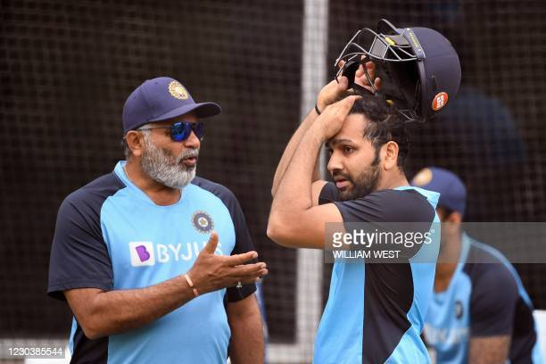 India's Rohit Sharma chats with the team's bowling coach Bharat Arun during a training session at the MCG in Melbourne on January 2 ahead of the...