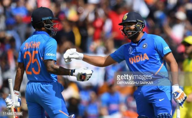 India's Rohit Sharma congratulates India's Shikhar Dhawan after a boundary during the 2019 Cricket World Cup group stage match between India and...
