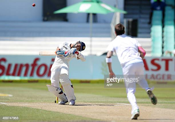 India's Rohit Sharma ducks from a bouncer by South Africa's Dale Steyn during the fifth day of the second and final cricket Test match between South...