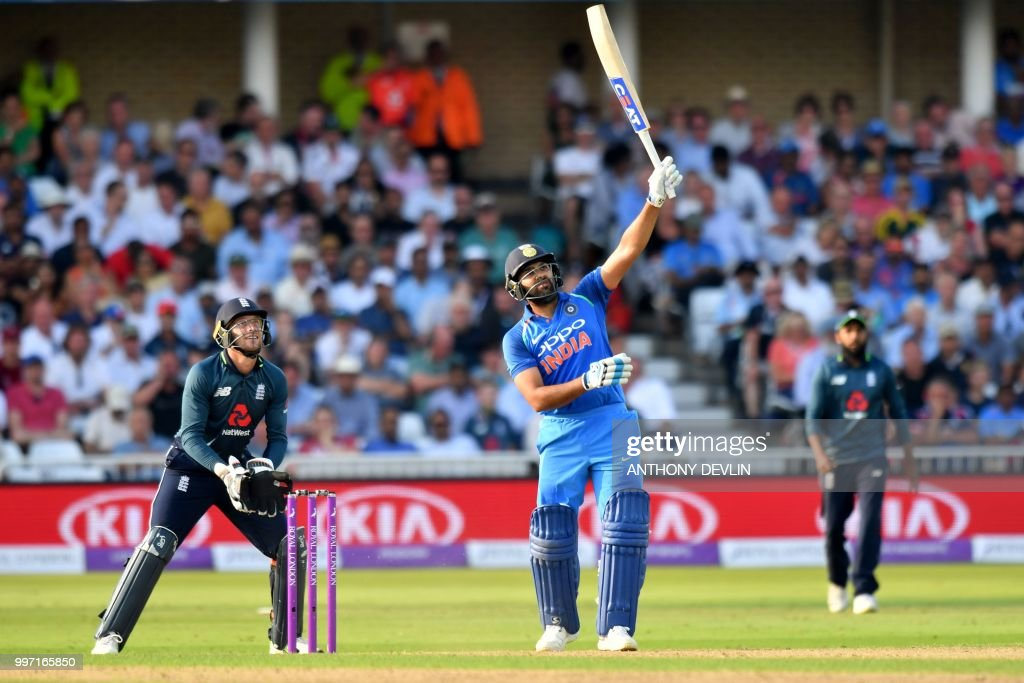India's Rohit Sharma hits a six during the One Day International (ODI) cricket match between England and India at Trent Bridge in Nottingham central England on July 12, 2018. (Photo by Anthony Devlin / AFP) / RESTRICTED
