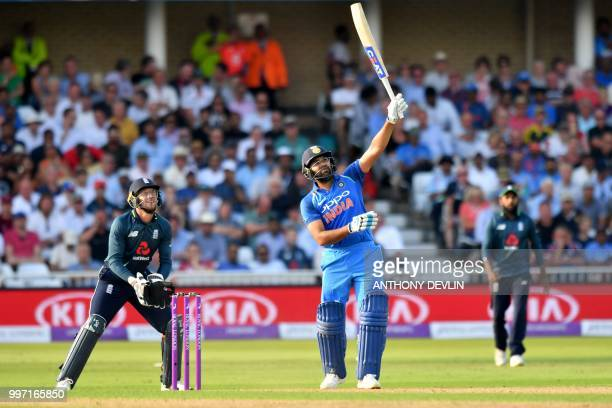 India's Rohit Sharma hits a six during the One Day International cricket match between England and India at Trent Bridge in Nottingham central...