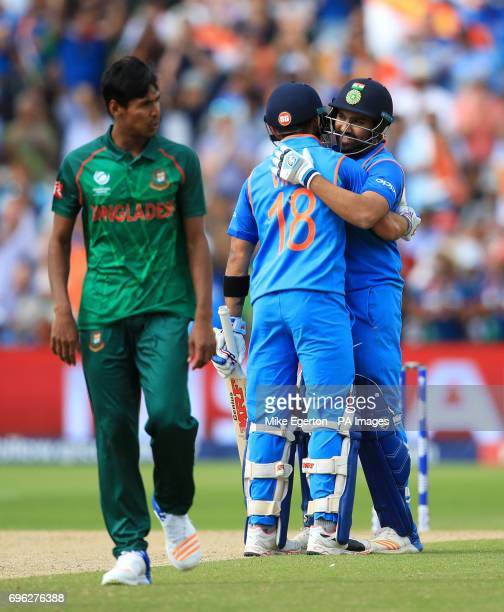 India's Rohit Sharma is congratulated on reaching his century by teammate Virat Kohli during the ICC Champions Trophy semifinal match at Edgbaston...