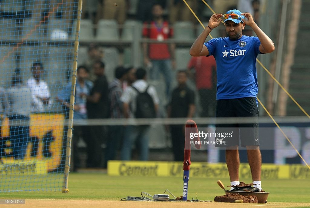 India's Rohit Sharma looks at the pitch during a training session on the eve of the fifth one day international (ODI) cricket match between India and South Africa at The Wankhede Stadium in Mumbai on October 24, 2015.