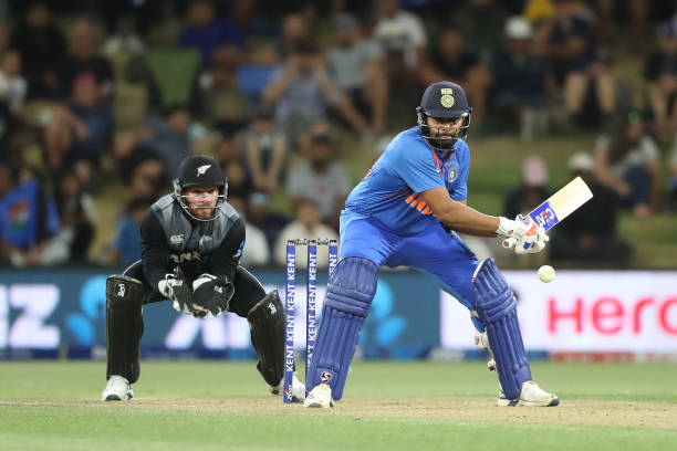 Indias Rohit Sharma plays a shot as New Zealands wicketkeeper Tim Seifert reacts during the fifth Twenty20 cricket match between New Zealand and...