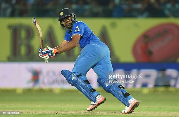 India's Rohit Sharma plays a shot during the first T20 cricket match between India and South Africa at The Himachal Pradesh Cricket Association...